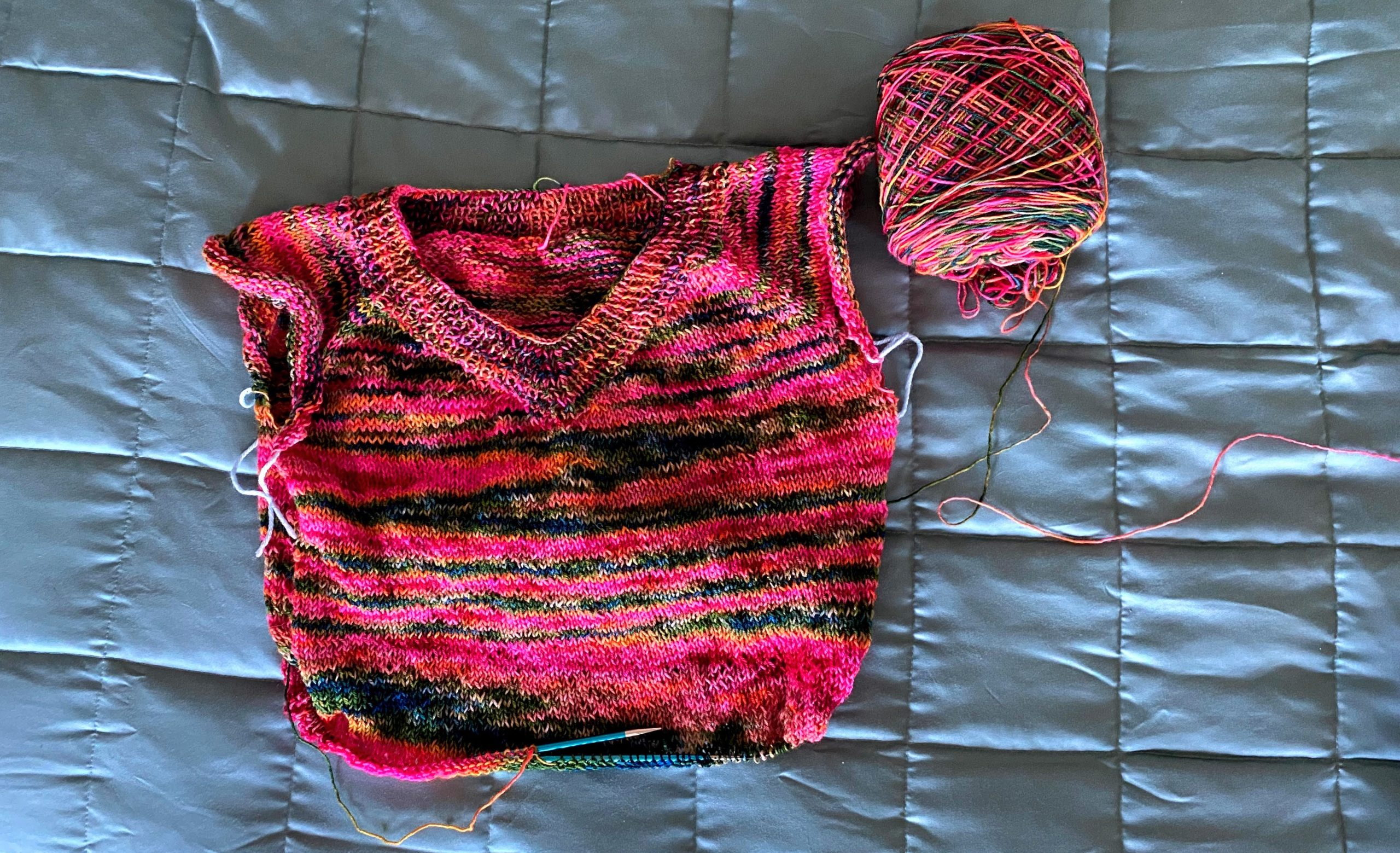 A brightly colored partially finished sweater
